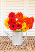 Bouquet of gerbera flowers on wooden table — Стоковое фото