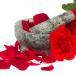 Mortar with rose фтв petals — Stock Photo
