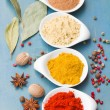 Colorful spices on blue table — Stock Photo #30136029