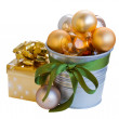 Golden christmas decorations with gift box — Stock Photo