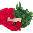 Bunch of red roses with empty tag — Stock Photo #30326301