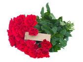 Bunch of red roses with empty tag — Stock Photo