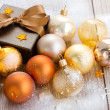 X-masgolden balls  and gift box — Stock Photo