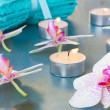 Burning candles and orchid flowers — Stock Photo