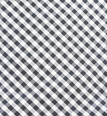 Black and white checkered fabric closeup — Stock Photo