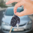 Hand holding a car keys — Stock Photo