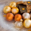X-mas golden balls  and present — Stock Photo