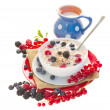 The oat flakes porridge with berries and milk — Stock Photo #31923845