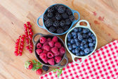 Three bowls of fresh raspberry — Stock Photo