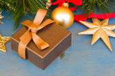 X-max present box under fir tree — Stock Photo
