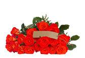 Rosas naranjas brillantes con etiqueta — Foto de Stock