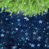 Christmas background with fir traa and stars — Stock Photo