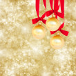 Three christmas balls on golden background — Stock Photo