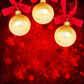 Three christmas balls on red background — Stok fotoğraf