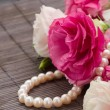 Eustoma flowers and pearls — Stock Photo