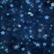 Christmas stars on blue background — Stock Photo #32868279