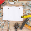 Empty note with tools kit — Stock Photo