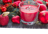 Christmas red cansle and heart decorations — Stock Photo