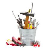 Set of tools in metal pot — Stock Photo