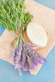 Lavender flowers and green soap bar — Stock Photo