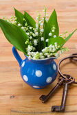 Lilly of the valley bouquet in pot — Stock Photo