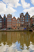 Medieval houses over canal water in Amsterdam — Stock Photo