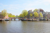 Amstel river and embankment, Amsterdam, Holland — Stock Photo