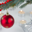 Red ball and christmas lights — Stockfoto