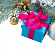 Fir tree branch, decorations and gift box — Stock Photo #33909879