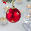 Red hanging ball and christmas lights — Stok fotoğraf