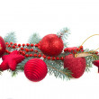 Fir tree branch and red christmas decorations — Foto de Stock