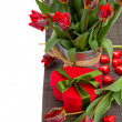 Tulip flowers in pot with heart gift box — Stock Photo
