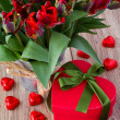 Gift boc with bouquet of  red tulips — Stock Photo