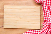 Cutting board and red napkin — Stock Photo