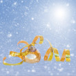 Golden chrismas ball in snow — Stock Photo