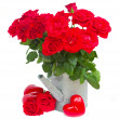 Red roses in watering can with hearts — Stock Photo