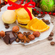 Yellow macaroons with christmas  decorations — Stock Photo