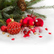 Evergreen tree and red christmas decorations — Stock Photo