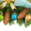 Fir tree with  christmas decorations and cones — Stock Photo