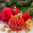 Red christmas ball under evergreen tree — Stock Photo