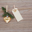 Christmas golden heart with tag — Stock Photo