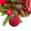 Evergreen  tree with red christmas decorations and cones — Stock Photo