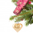 Christmas golden heart hanging on fir tree — Stock Photo
