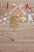 Chrismas decorations hanging on clotheline — Stock Photo