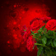 Scarlet roses on dark background — Stock Photo #36075999