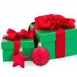 Stock Photo: Green gift boxes and christmas red decorations