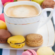 Cup of coffee and plate of  macaroons — Stok fotoğraf