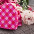 Pink heart box with pearls and flowers — Stock Photo