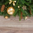 Golden decorations green fir tree border — Stock Photo