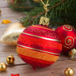 Red and orange ball  on fir tree — Stock Photo
